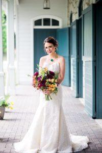 lace wedding dress bold bridal jewelry maroon red magenta orange yellow purple bridal bouquet