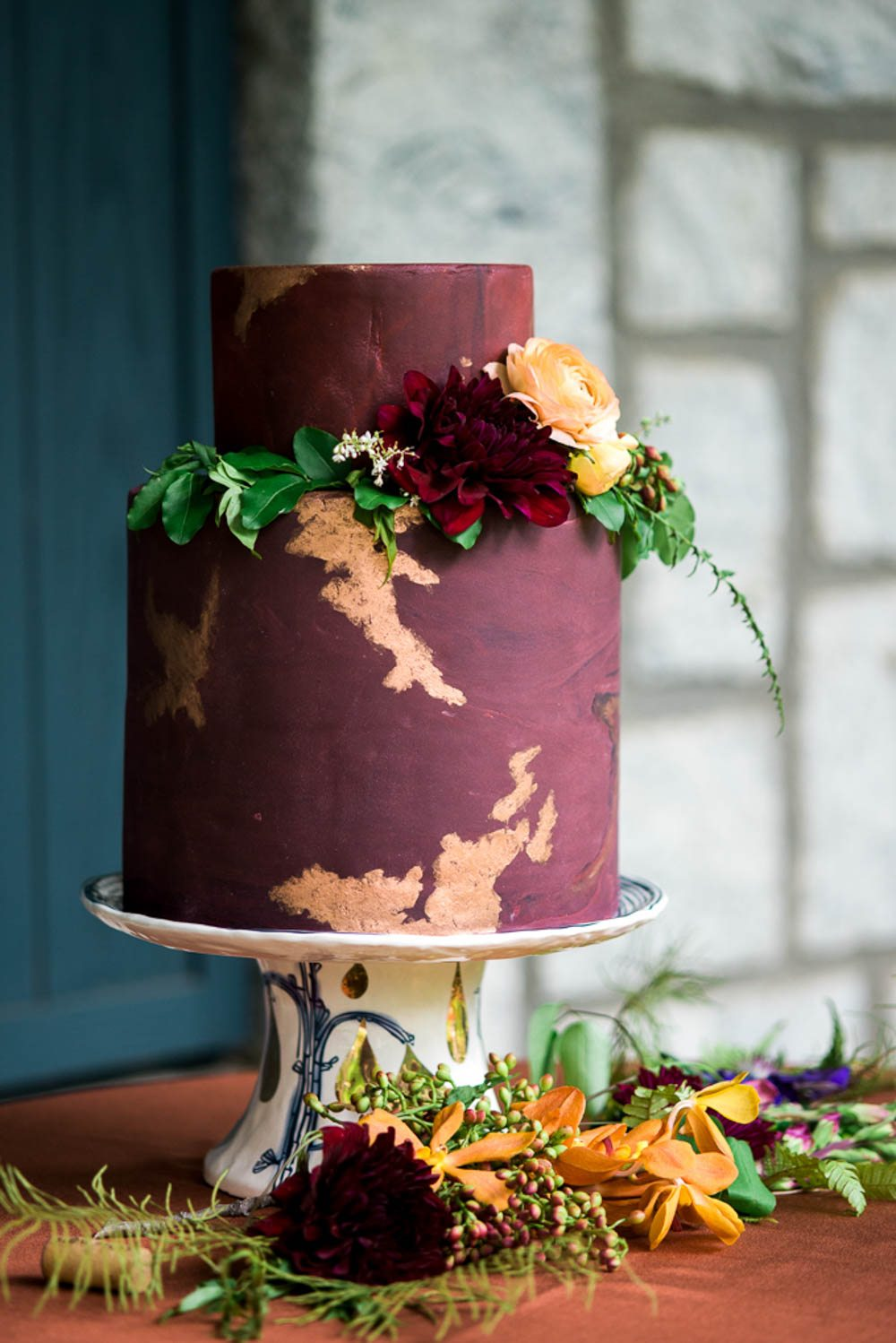 magenta gold leaf detail floral wedding cake