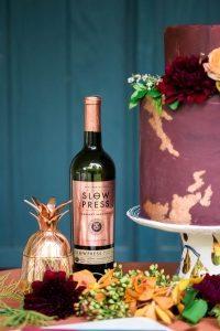 gold leaf floral detailed wedding cake maroon orange red wine table gold pineapple wedding decor