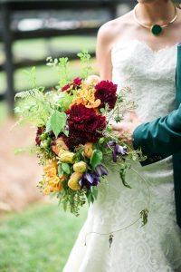multicolored bridal bouquet maroon purple red orange yellow