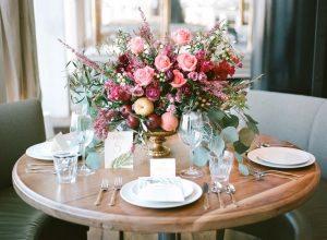 pink white flower centerpiece peaches apples