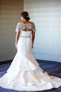 ruffled wedding dress beaded lace details bridal updo hair silver hair accessories