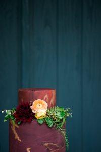 maroon gold leaf floral wedding cake