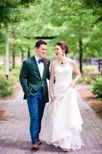 colorful wedding lace strapless wedding dress emerald green tuxedo orange boutonniere bold bridal jewelry