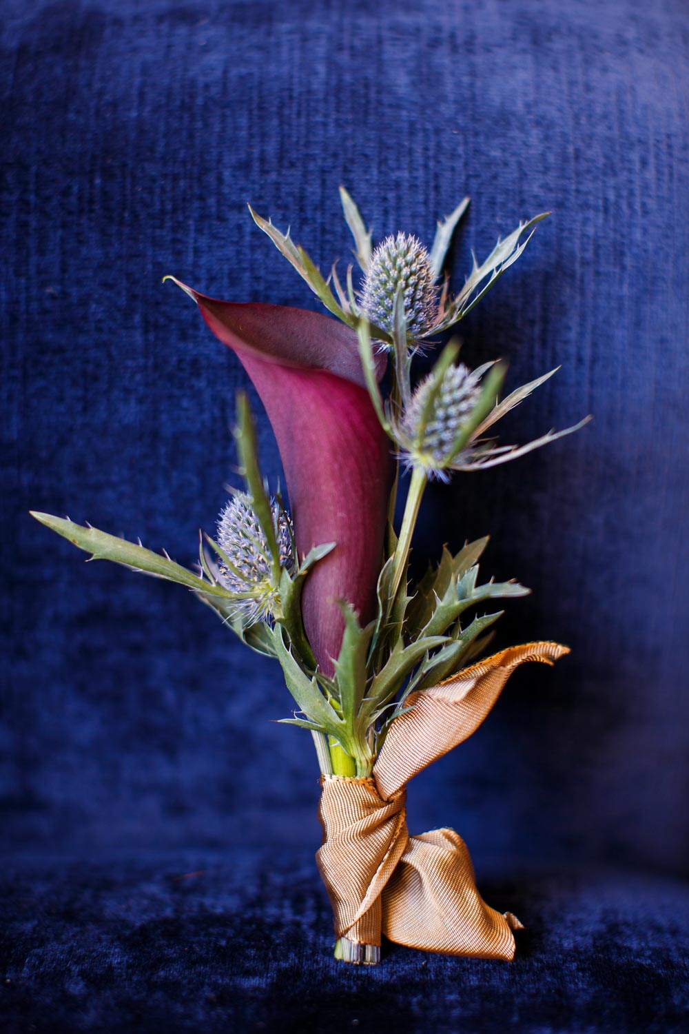 plum purple gold boutonniere
