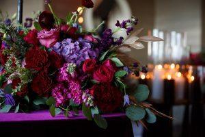 purple pink red floral arrangements centerpieces
