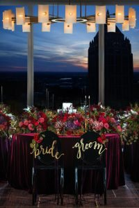 wedding reception tables red purple pink gold gold chair decorations candles
