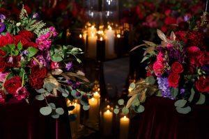 centerpieces flower arrangements red purple pink gold candles