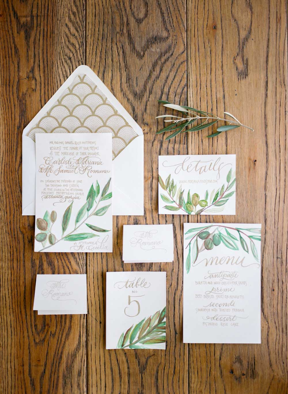 white gold green leaf decorated invitation