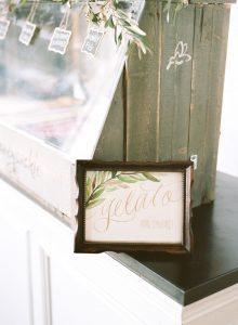 wood frame gold gelato sign with leaf design