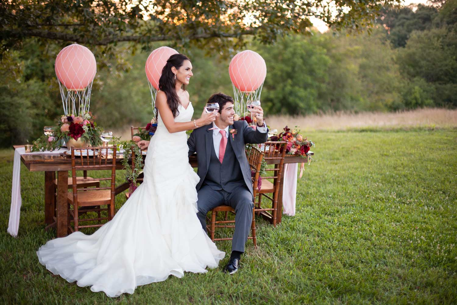 bride-and-groom-at-outdoor-reception-chey-photography-sweet-meadow-109