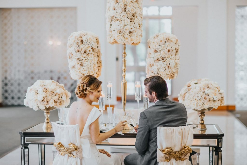 bride-and-groom-at-reception-tables-rad-red-creative-the-vault-98