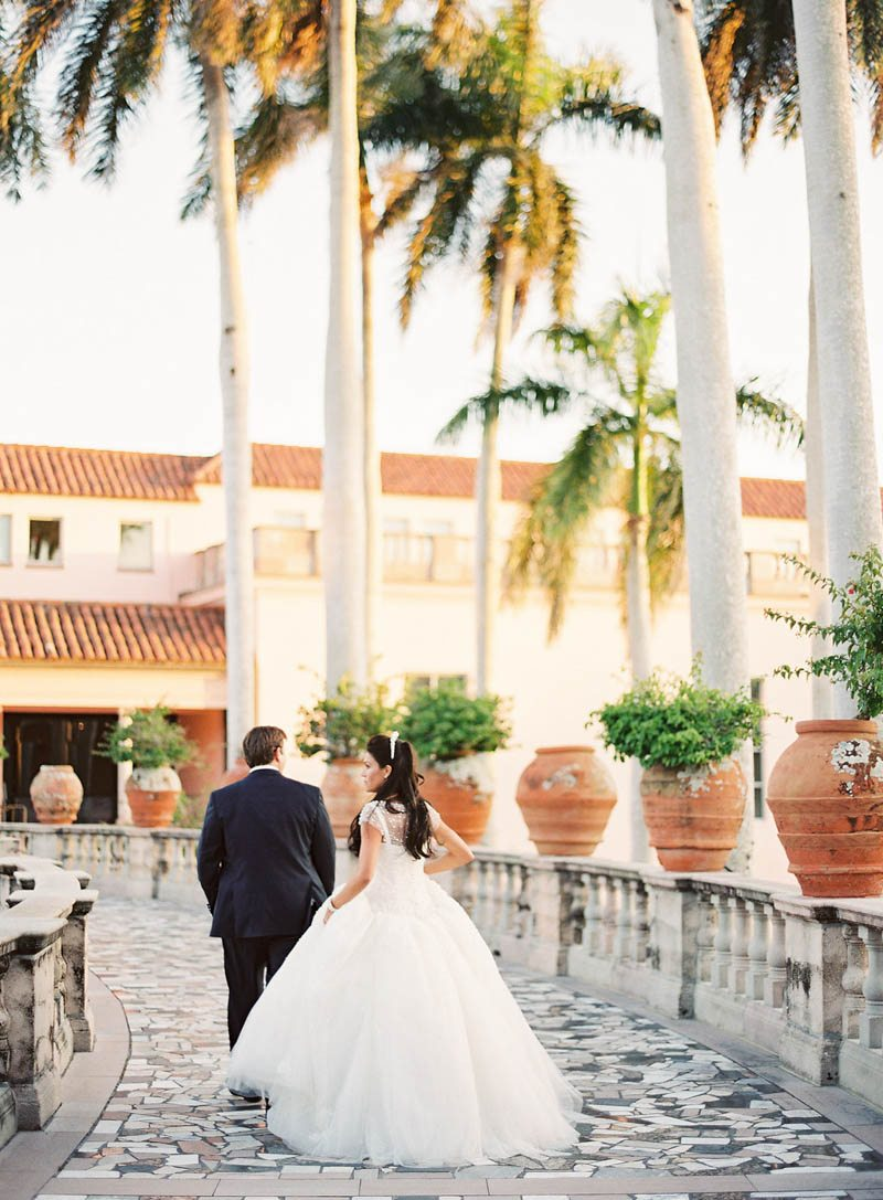 bride-groom-outdoor-palm-tree-garden-justin-demutiis-784
