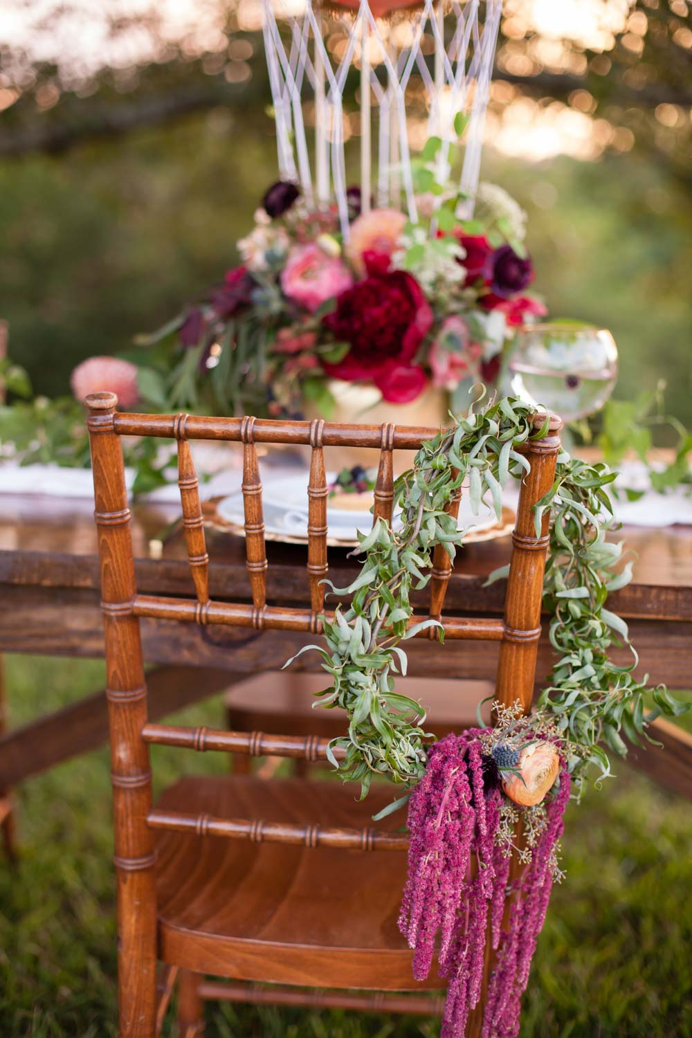 greenery-on-reception-chairs-chey-photography-sweet-meadow-103