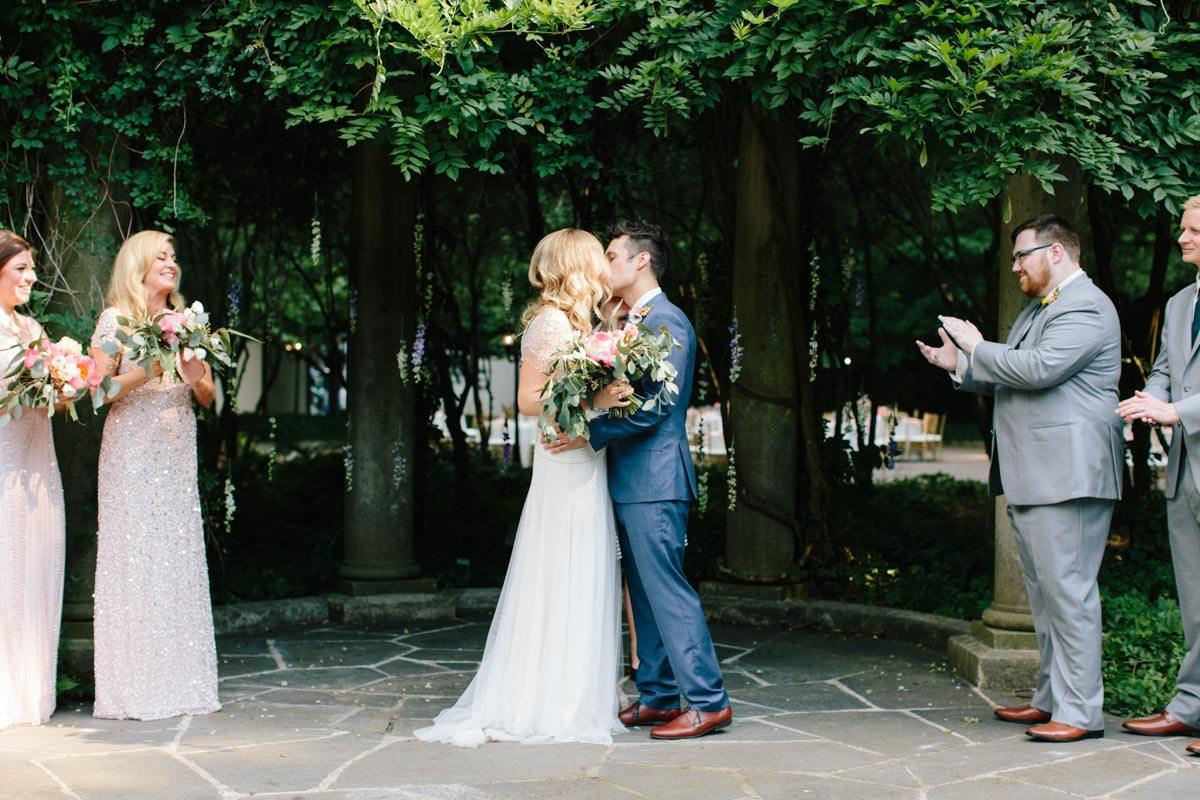 outdoor-wedding-cator-woolford-gardens-first-kiss