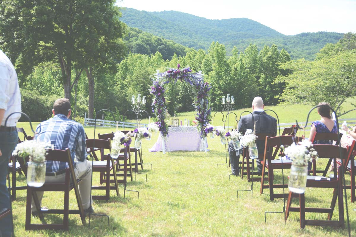 Outdoor Mountain Wedding Ceremony Setup Purple Fl Arch Laurel Farm Six Hearts Photography