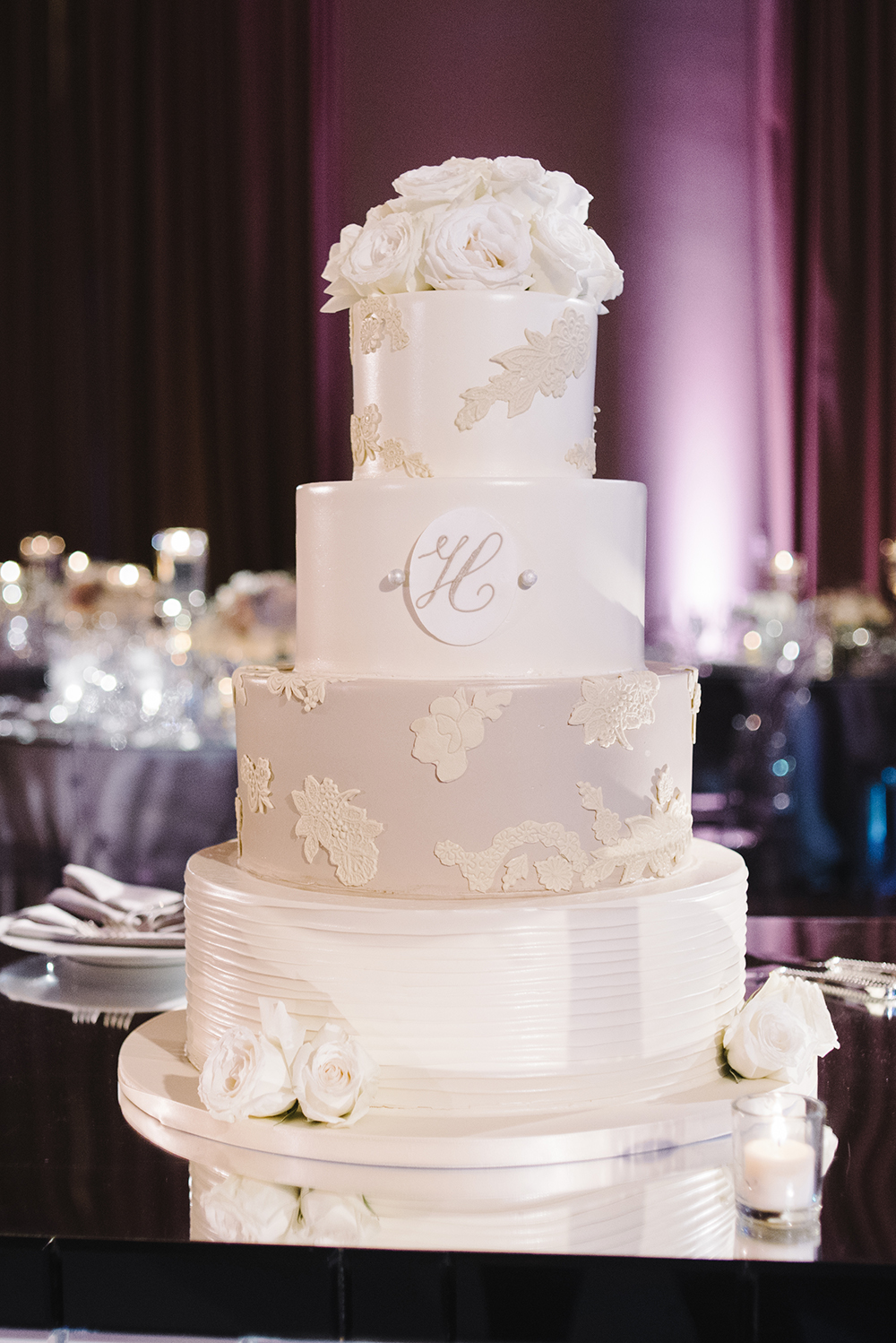 5 tiered white wedding cake with lace