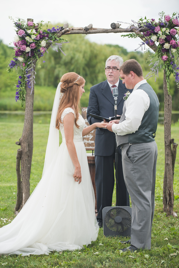 Bride and groom at floral alter