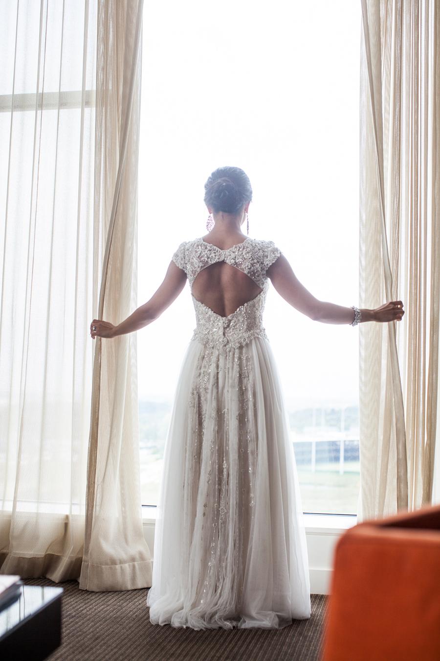 Peek-a-boo back lace wedding dress