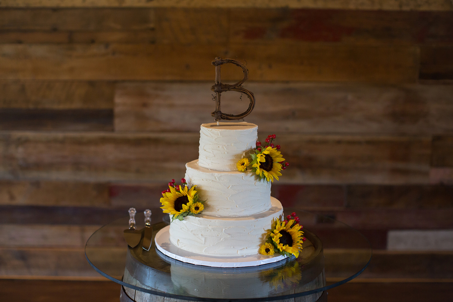 White sunflower wedding cake
