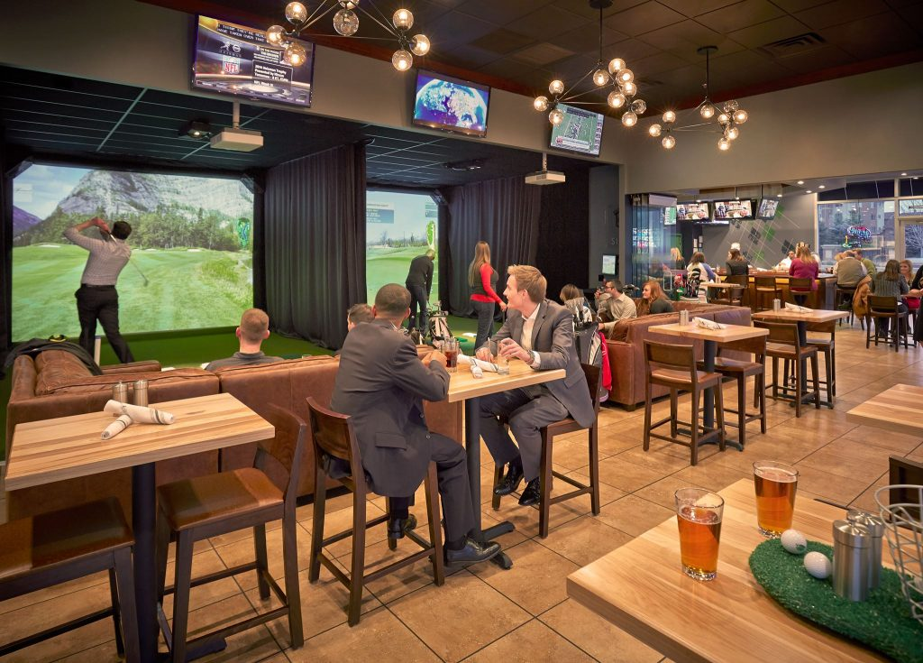 Play virtual golf at Tap Inn Pub at Hotel Arista