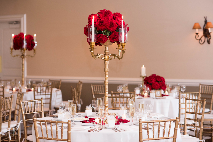 Red rose centerpiece with gold candelabras