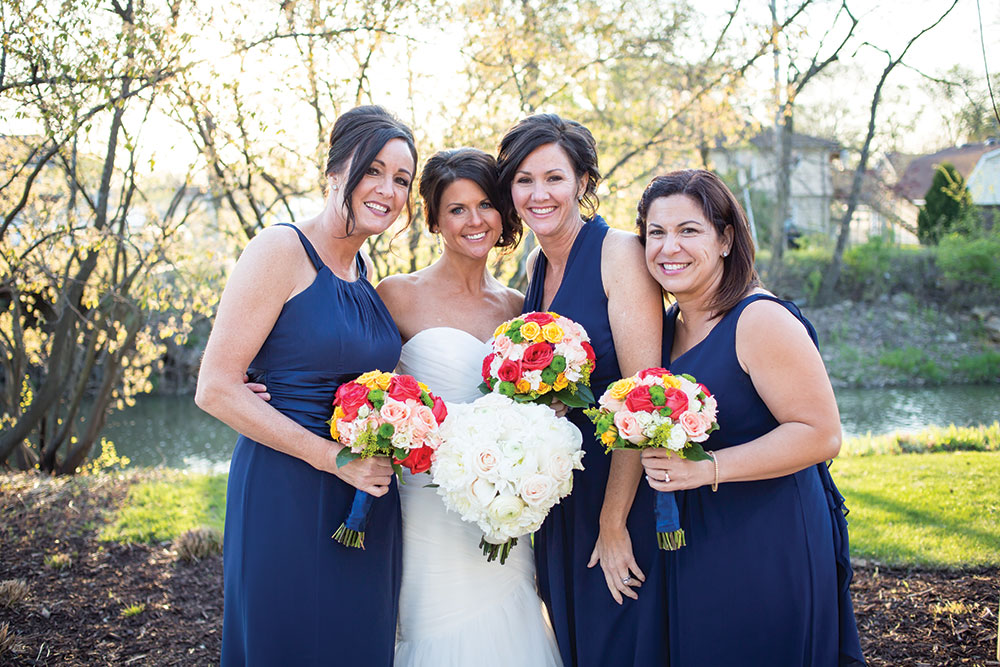 Navy bridesmaid dresses and colorful wedding bouquets