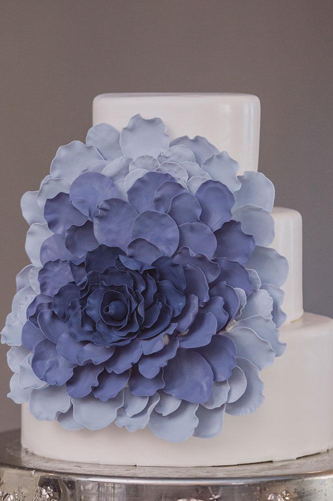 Gorgeous purple flower wedding cake