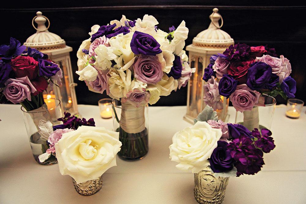 Purple wedding flowers and lanterns