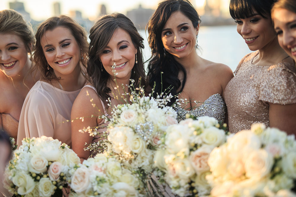 Beautiful bridesmaids with bouquets