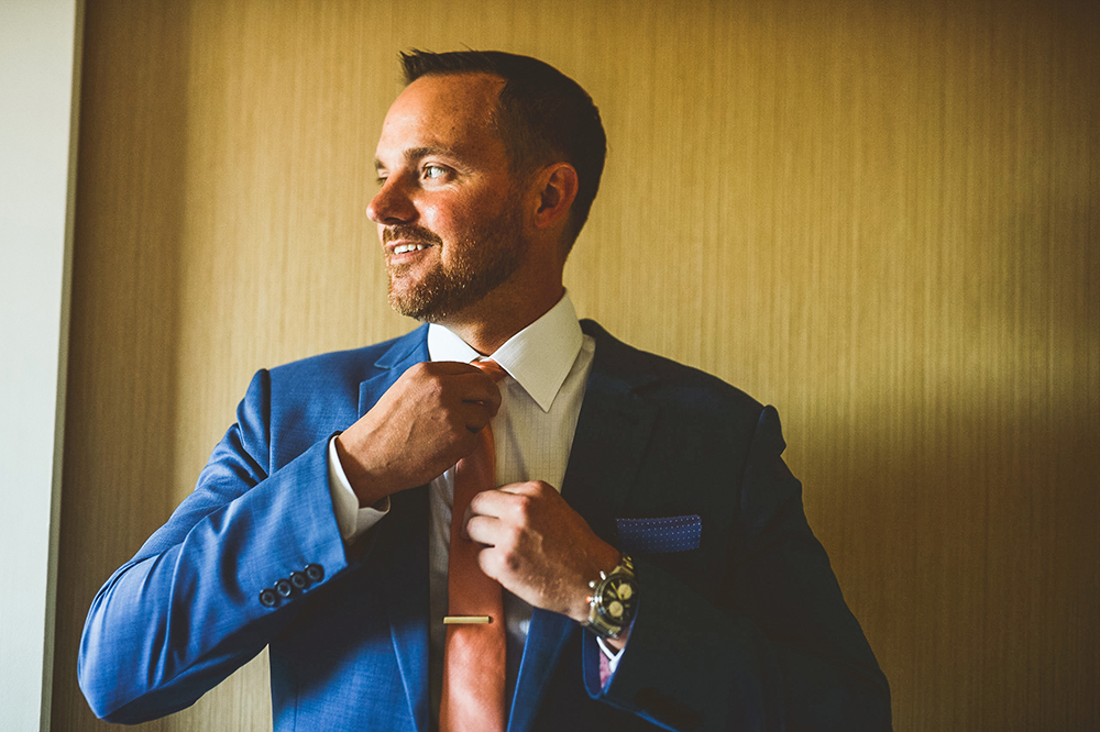 Groom in navy tux