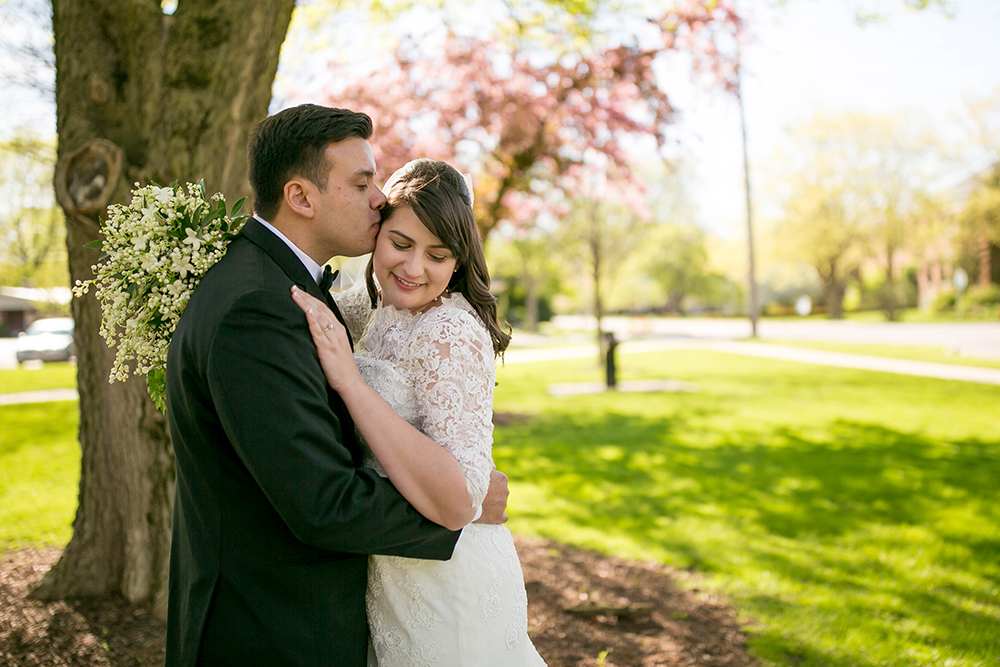 Bride and groom kissing at golf course