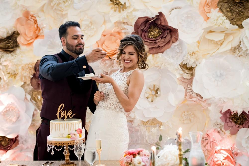 Claudia and Juan cake flower wall