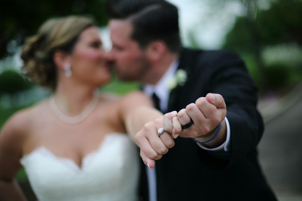 Delaney and Ross wedding rings portrait