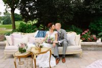 arrowhead styled shoot couch couple kiss