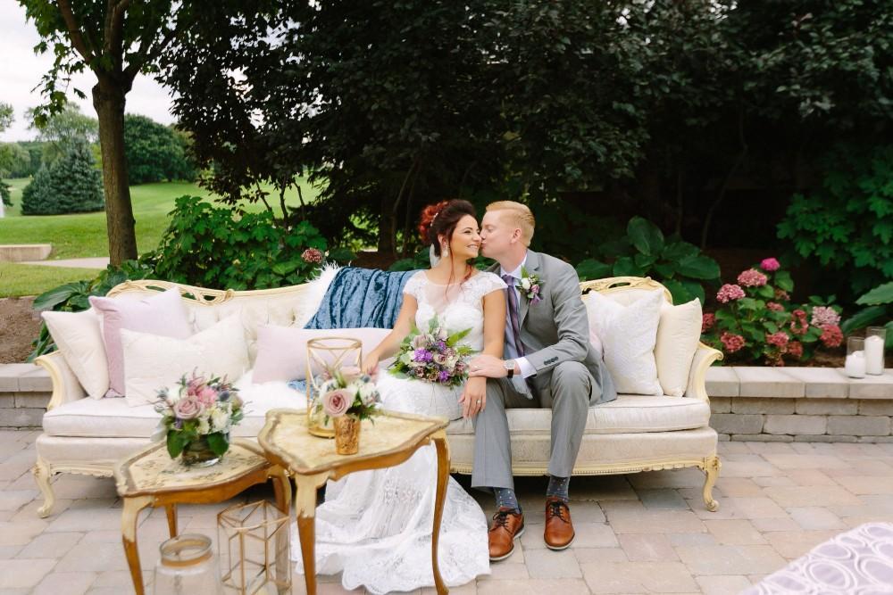 arrowhead styled shoot couch couple kiss