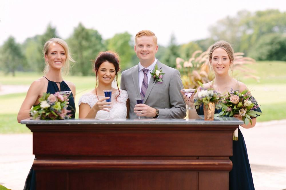 garden party bride and groom with bridal party drinks