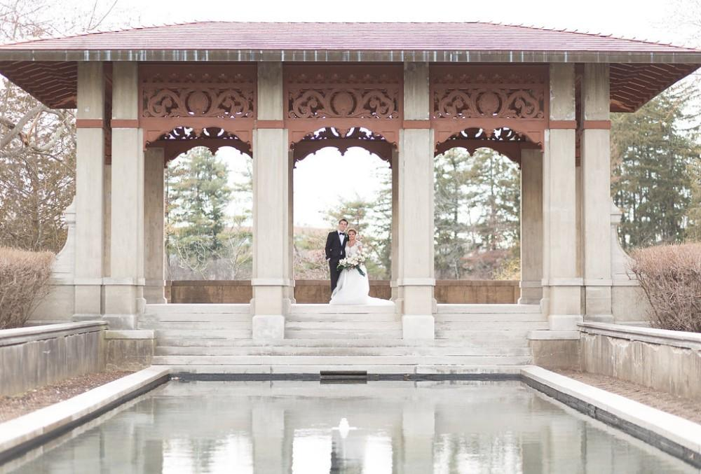 romantic greenery bride and groom portrait pagoda