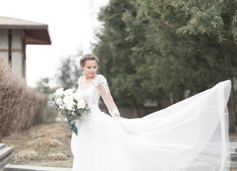 romantic greenery bride train blowing in wind