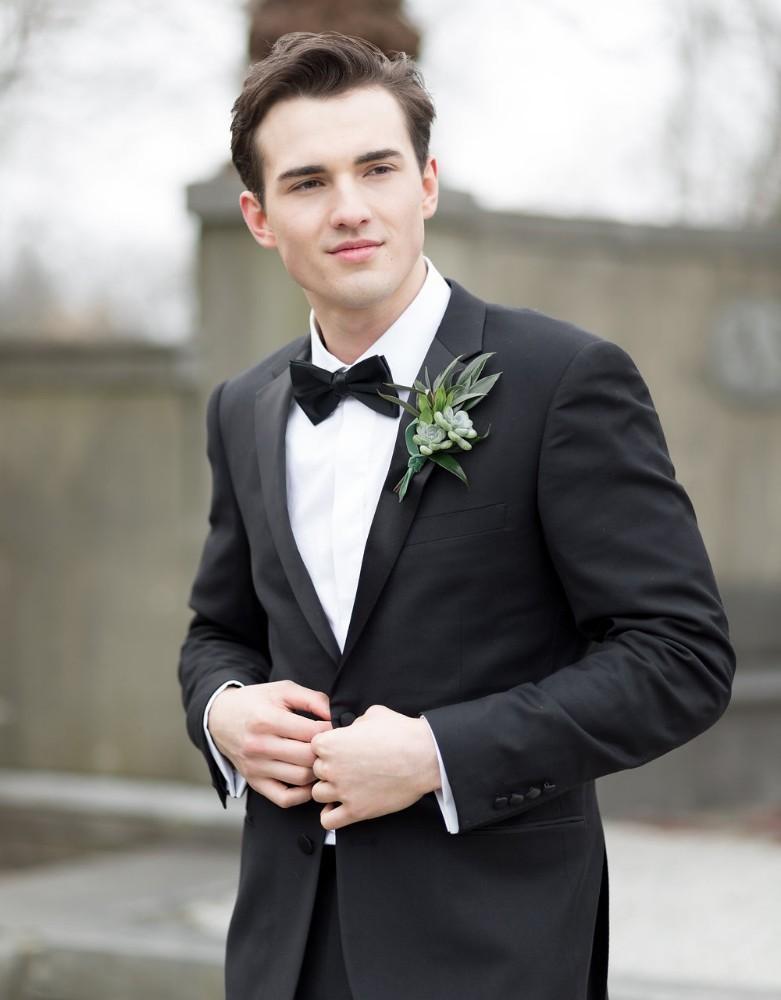 romantic greenery groom portrait