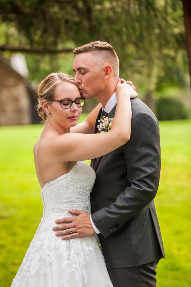 glasses bride and groom portrait