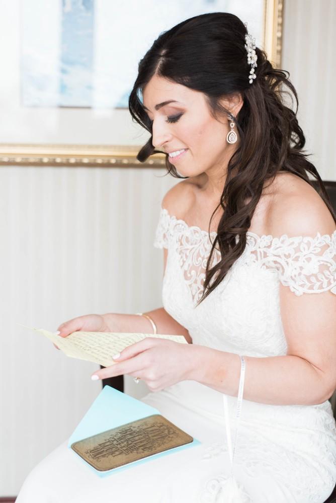 Christine Ken bride getting ready card from groom