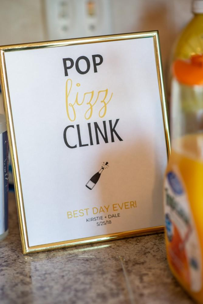 Kirstie Dale pop fizz clink sign
