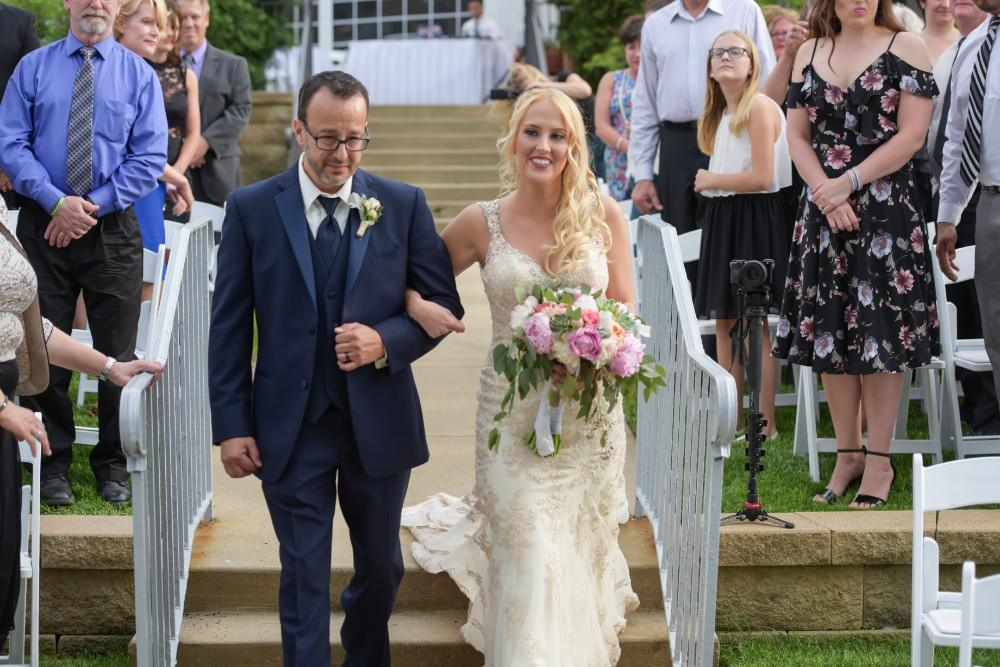 Kirstie Dale walking down aisle with dad