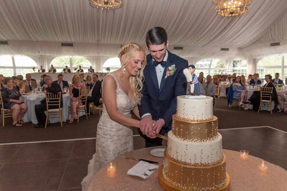 Kirstie Dale cutting cake