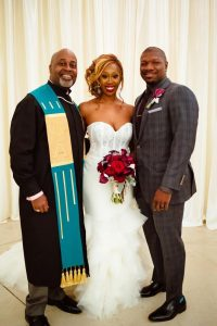 dominique and william bride and groom with officiant