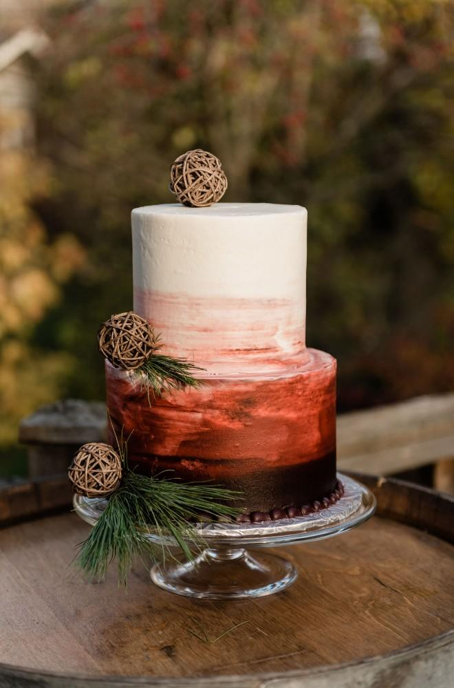 thanksgiving inspired wedding cake with pinecones