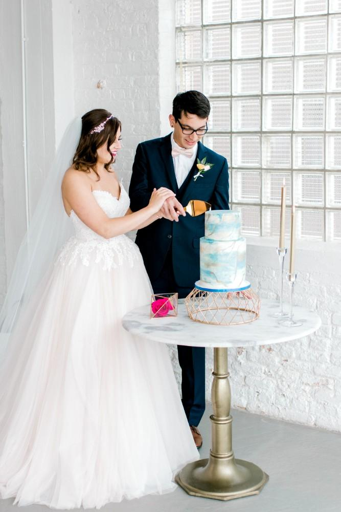 styled shoot bold colors room 1520 cutting cake