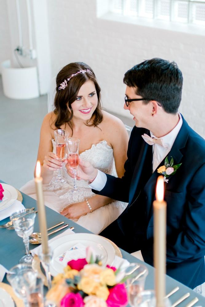 styled shoot bold colors room 1520 couple toasting