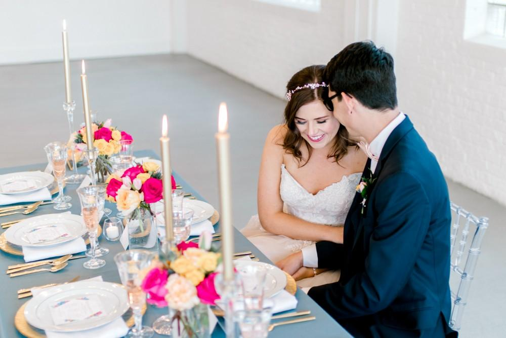 styled shoot bold colors room 1520 couple at table